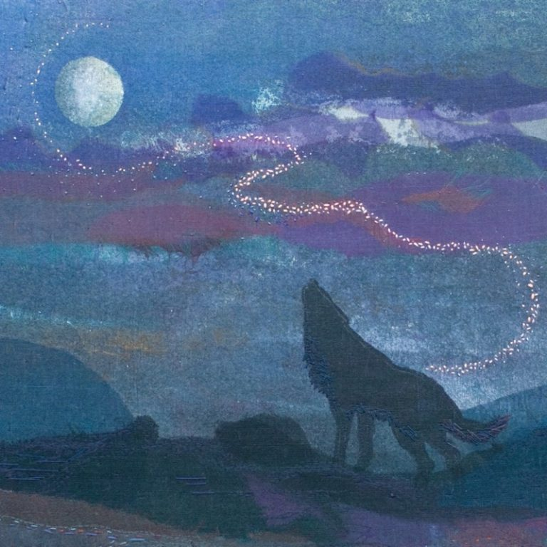 Embroidery of wolf howling at a full moon